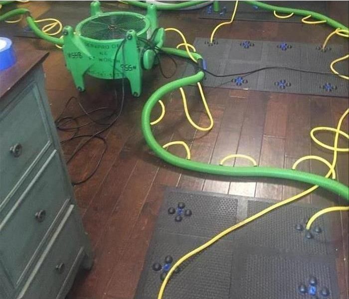 drying mats on hardwood floor
