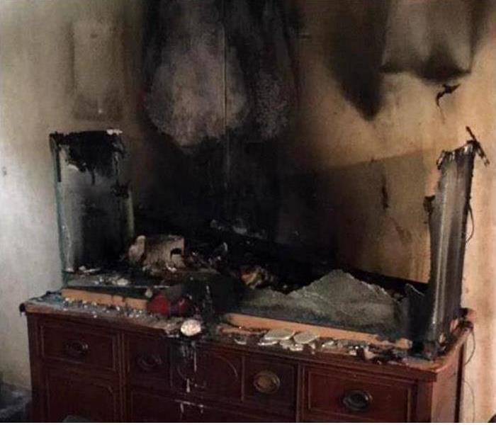 a kitchen that has been burned down and has major fire damage