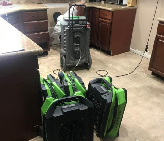 SERVPRO drying equipment in water damaged kitchen